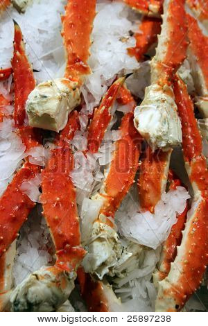 Cooked Alaska King Crab Legs on ice for sale at a public market
