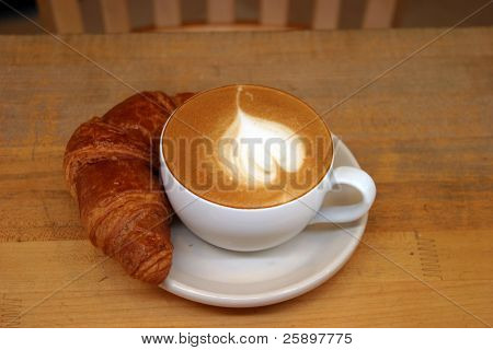 Seattles favorite drink Coffee with a croissant