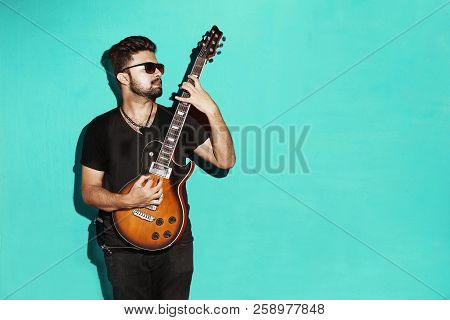 Closeup Of One Handsome Passionate Expressive Cool Young Brunette Rock Musician Men Playing Electric