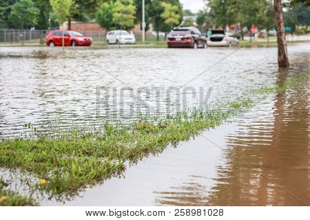 Stormwater flooding a road with stalled cars in the background poster