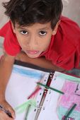Top-view of bored little boy at school poster