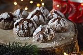 Chocolate Crinkle Cookies  in powdered sugar and Christmas decoration, rustic style poster