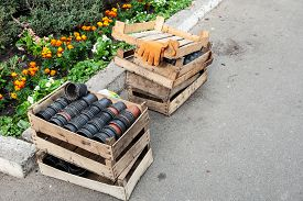 Empty Pots For Seedlings In A Wooden Box Near A Flower Bed With A Place For Text