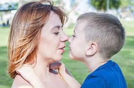Young And Beautiful Caucasian Woman Looking At Her Son, Face To Face Close Up Portrait, Mother Child