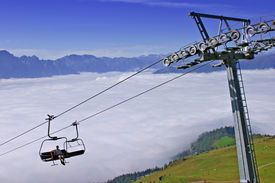 Chairlift Above Clouds