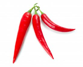Three Chilli Peppers Isolated On White Background