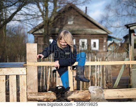 Funny Girl Climbs Over The Village Fence