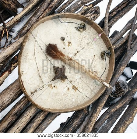 Shaman Tambourine With A Clapper On The Background Of Yaranga Flooring. The Ritual Instrument Of The