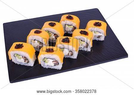 Traditional Fresh Japanese Sushi Rolls On Black Stone Unagi Cheeses On A White Background. Roll Ingr