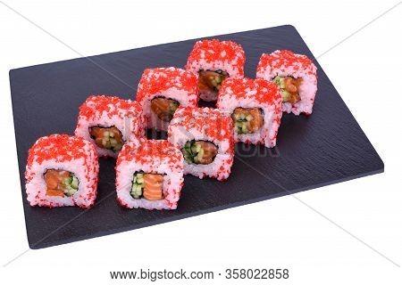 Traditional Fresh Japanese Sushi Rolls On Black Stone California Ebi On A White Background. Roll Ing