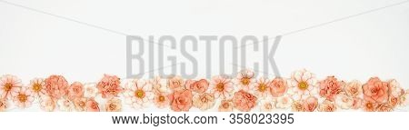 Mothers Day Or Spring Bottom Border Of Pink Paper Flowers. Top View Over A White Background. Copy Sp