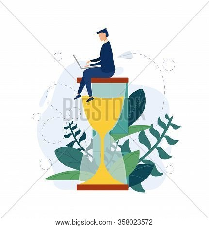 Businessman Work On The Hourglass Relaxed And Concentrated. Business Concept Of Time Management And