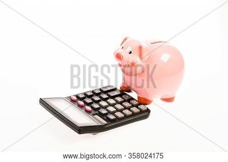Piggy Bank Money Savings. Piggy Bank Pig And Calculator. Credit Debt Concept. Economics And Profit M