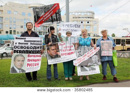 MOSCOW - MAY 24: Supporters of Mikhail Khodorkovsky picketed near building Moscow City Court on May 24, 2011 in Moscow, Russia. Khodorkovsky sentenced for theft of oil to 13 years in prison.