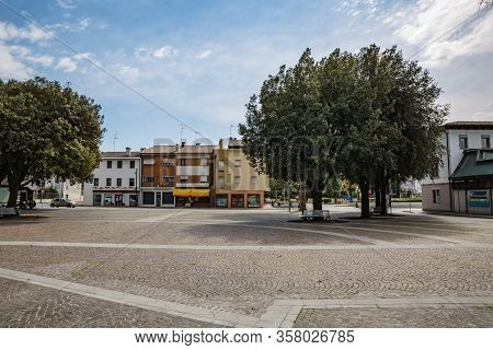 Manzano, Italy - 25.03.2020: Little Italian City During An Epidemic. Deserted Central Square. No Peo