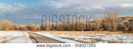 winter scenery on a bike trail - panorama of Poudre River Trail in northern Colorado, biking, recreation and commuting concept