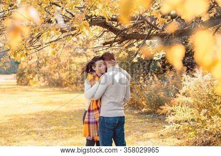 Portrait Of Beautiful Couple Man Woman In Love. Boyfriend And Girlfriend Hugging, Smiling Outdoor In