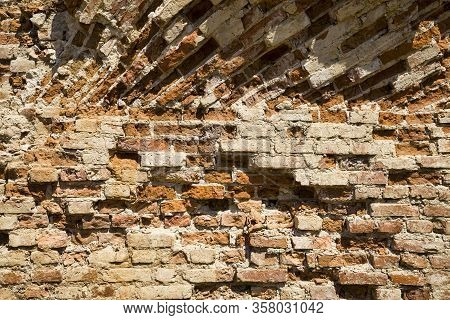 Complex And Interesting Historical Red Brick Masonry, Part Of The Ruins And Ruined Walls Of A Mediev