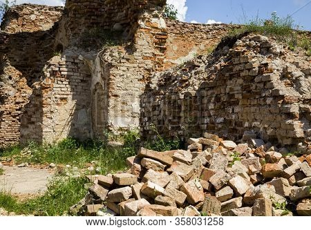 Old Clay Orange Bricks In An Abandoned Ruined Red Brick Building, Castle Ruins In Europe