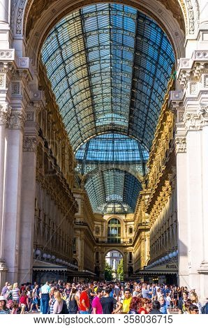 Milan, Italy, September 9, 2018: Crowd Of People Are Walking Near Gallery Vittorio Emanuele Ii Galle