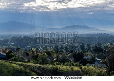 Morning sunbeams and strom clouds above the San Fernando Valley area of Los Angeles in Southern California.