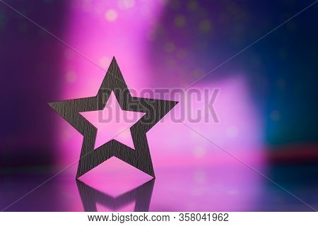 Wooden Icon Of White Star With Hole On Pink And Purple Dark Galactic Background With Light Bokeh. Fe