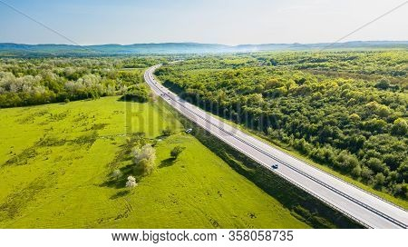 View From The Drone On The Road Stretching Into The Distance Beyond The Horizon