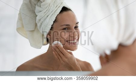 Pretty 30s Woman Holding Cotton Pad Cleanses Skin Removes Impurities