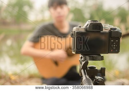 Blogger Boy Showing Play Guitar Streaming With Fan Page Follower By Internet Online 5G