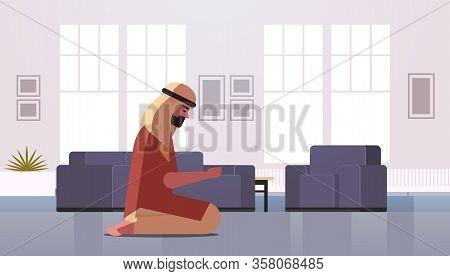 Religious Muslim Man Kneeling And Praying At Home Ramadan Kareem Holy Month Religion Concept Modern