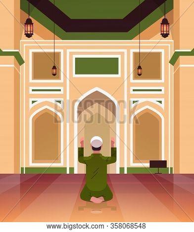 Religious Muslim Man Kneeling And Praying Inside Mosque Building Ramadan Kareem Holy Month Religion