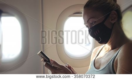 Woman Travel Tourist Caucasian At Plane Aircraft With Wearing Protective Medical Mask. Read Shock Ne