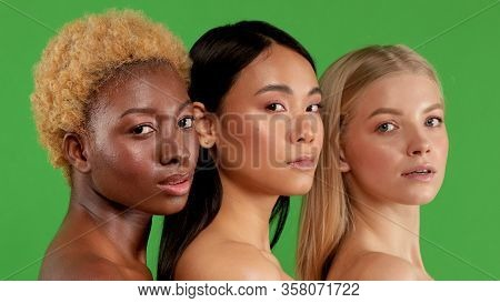 Portrait Of Three Cheerful Multinational Young Women With Attractive Appearance And Different Flawle