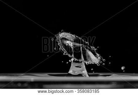 Macro Of Water Splash Drop On Black Background