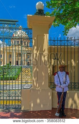 Santo Domingo, Dominican Republic - March 13, 2020: Soldier In Front Of The National Palace, A Build