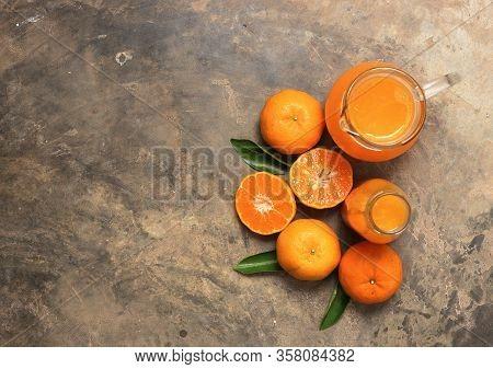 Top View Of Orange Juice On Cement Floor