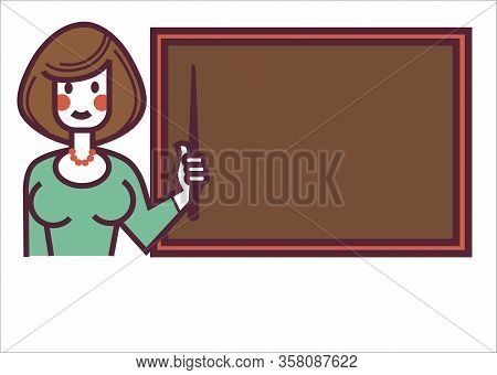 School Teacher Or Tutor Standing By Blackboard At Lesson