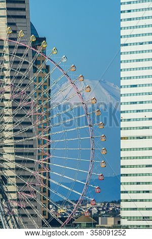 Yokohama Ferris Wheel Cosmo Clock 21 And Fuji Mountain In Japan
