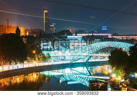 Tbilisi, Georgia - October 21, 2016: Evening Night Scenic View Of Skyscraper And Bridge Of Peace. St