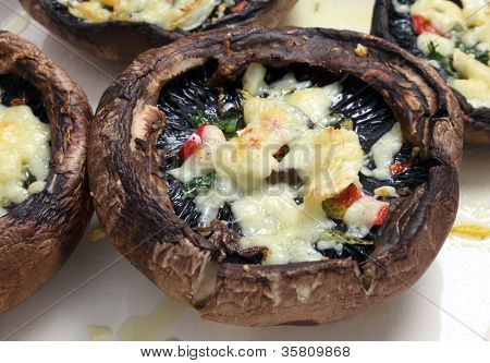 Portobello mushrooms, stuffed with chopped parsley, red chilli,lemon peel and grated cheese, fresh from the oven