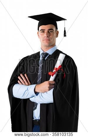 Portrait of a happy Caucasian male student wearing a gown and a hat holding a certificate graduating from high school college looking at camera smiling on white background.
