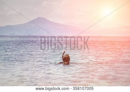 Underwater Hunter In The Background Of The Sunset.