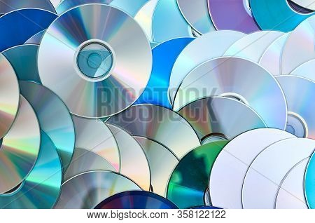 Group Of Old Cd Dvd Compact Optical Disk Storage Medium With Dust And Scratches