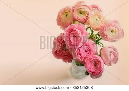 Bouquet Of Ranunculus Or Buttercup In The Glass Vase Closeup, Top View. Bouquet Of Ranunculus Of Pas