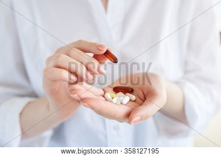 Vitamins And Supplements. Closeup Of Hand Holding Variety Of White Pills On Palm. Close-up Of Medica