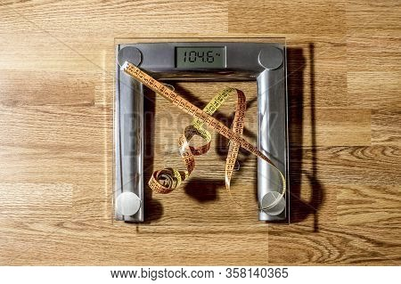 The Centimeter Tape Is On The Home Scale Showing A Lot Of Kilograms