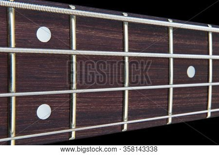 Four String Bass Guitar Fretboard Neck With Selective Focus