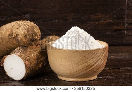 Manihot Esculenta - Raw Cassava Starch. Wood Background