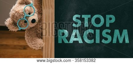 Stop Racism Text And Cute Teddy Bear School On Class Blackboard Background