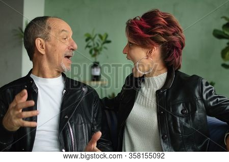 Emotional Family Portrait Of Adult Daughter And Senior Father In Loft Room With Houseplants. Screami